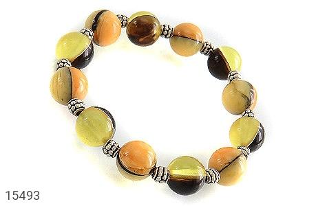 دستبند کهربا پودری خوش رنگ زنانه - عکس 1