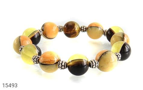 دستبند کهربا پودری خوش رنگ زنانه - تصویر 2