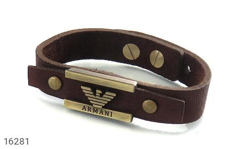 عکس دستبند چرم طبیعی بند دکمهای طرح اسپرت