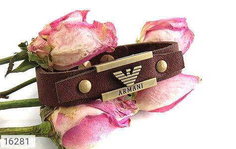 تصویر دستبند چرم طبیعی بند دکمهای طرح اسپرت - شماره 5