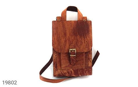 عکس کیف چرم طبیعی قهوه ای روشن طرح ابر وبادی دستی یا دوشی اسپرت