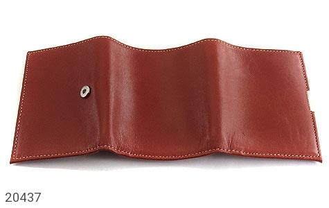 عکس کیف چرم طبیعی قهوه ای مایل به قرمز مدل جیبی دکمه دار - شماره 4