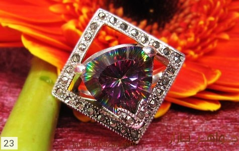 عکس انگشتر توپاز هفت رنگ درشت زنانه