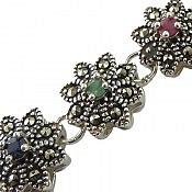 دستبند نقره زمرد و یاقوت طرح گل اشرافی زنانه